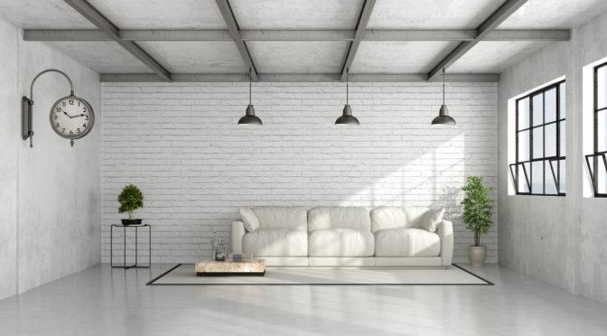 Sol en béton et large baie vitrée : optez pour un intérieur moderne